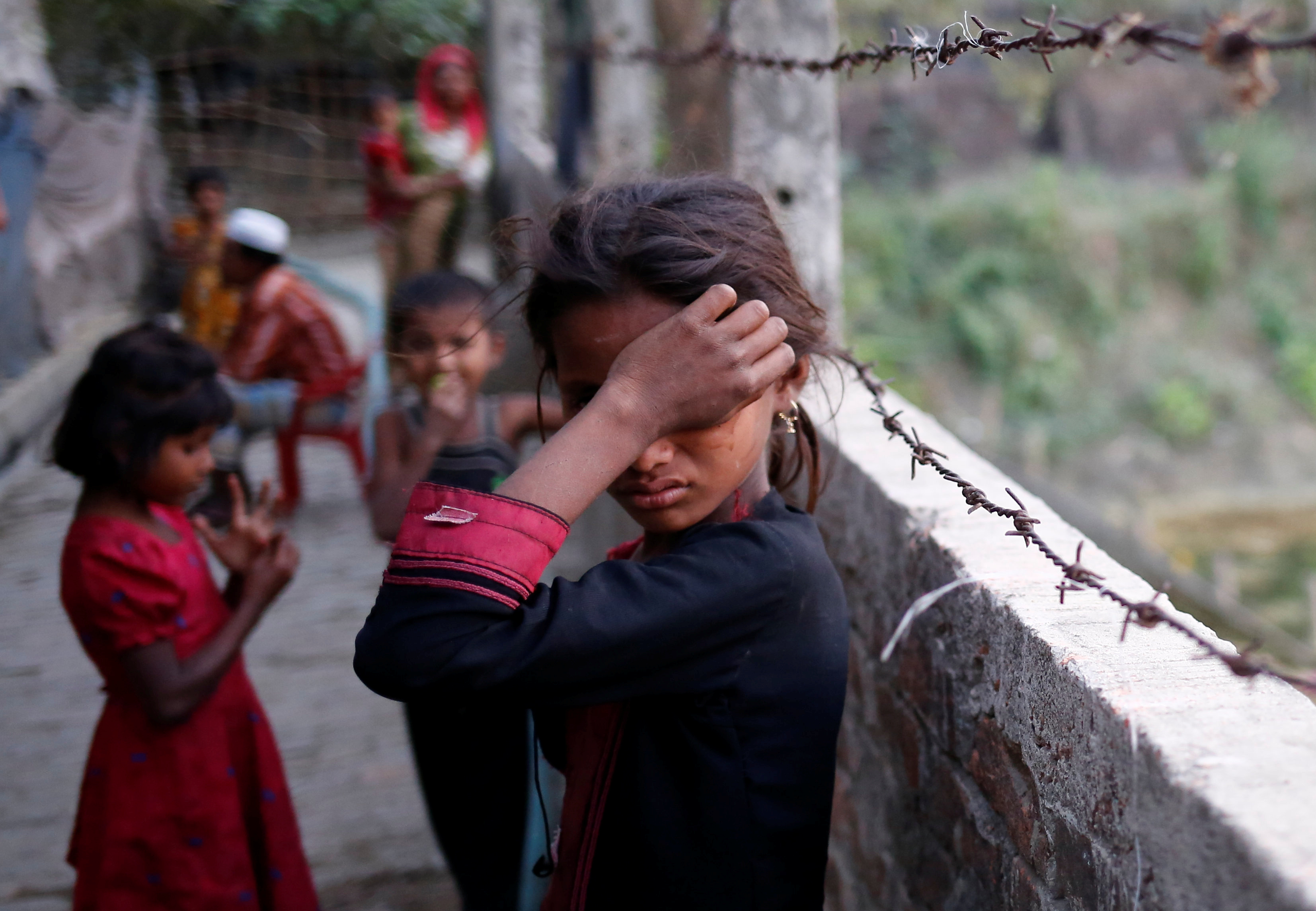 A Rohingya refugee girl wipes her eyes as she cries at Leda Unregistered Refugee Camp in Teknaf, Bangladesh, February 15, 2017. REUTERS/Mohammad Ponir Hossain      TPX IMAGES OF THE DAY - RTSYTH2